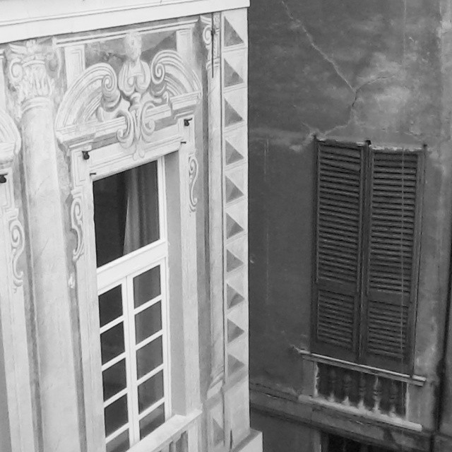 Loving all the frescoes on the buildings in #Genova. View out my apartment window. #b&w #italy #architecture