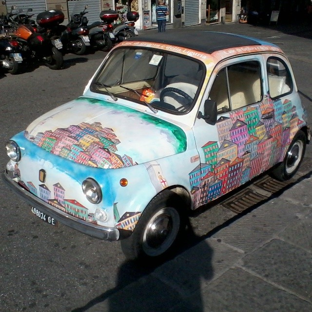 The buildings and colors of Liguria on a Fiat. Brilliant! #genova #italy #fiat500