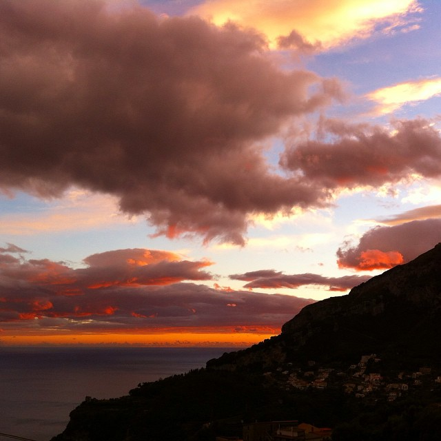 Today's sunset sums up the weather today - ominous clouds, blue sky and beauty all at once. #AmalfiCoast