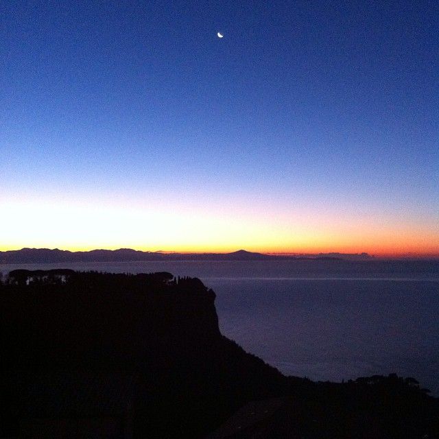 My phone camera doesn't do this justice, but it's just incredible this morning. There's a sliver of the moon all the colors of spectrum on the horizon. Buon giorno! #AmalfiCoast #besttimeoftheday