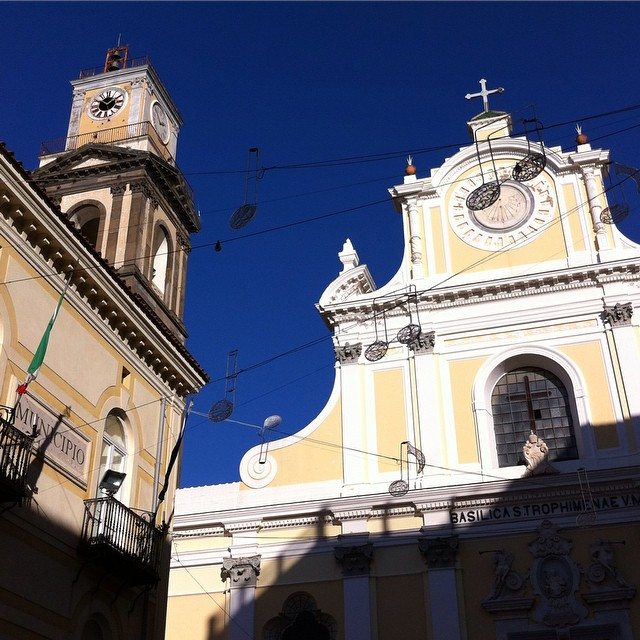 Stopping in Minori for some Christmas shopping. Holiday lights and sunshine on the Santa Trofimena church. #AmalfiCoast