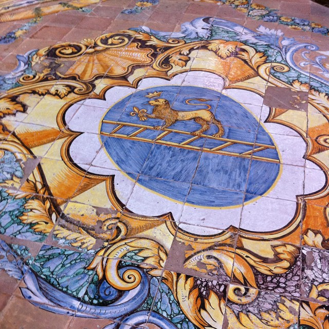 Detail of the hand painted tile floor in the Duomo of Scala. The word